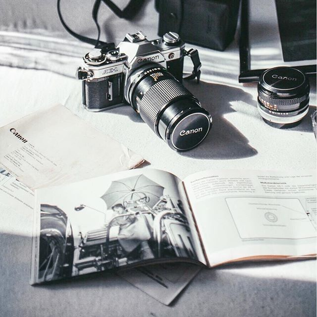 Parts of the Sun Photography   Old vintage camera, Canon ae-1 with the manual and few lenses