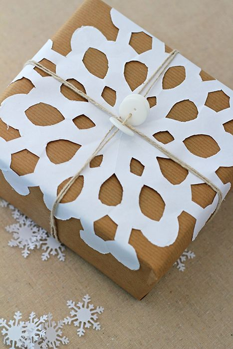 Snowflake Christmas Wrapping - Create a simple snowflake to jazz up plain gift wrapping.