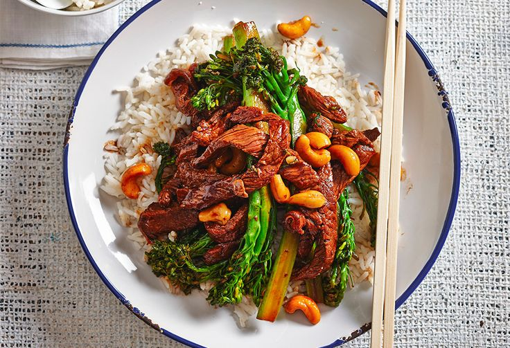 A beef and cashew nut, honey and black bean sauce stir-fry, with tender broccolini on a bed of rice