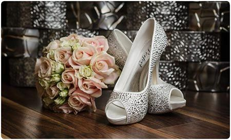 Holst Photography | Wedding Photographer Love the background in this shot of wedding flowers and bridal shoes