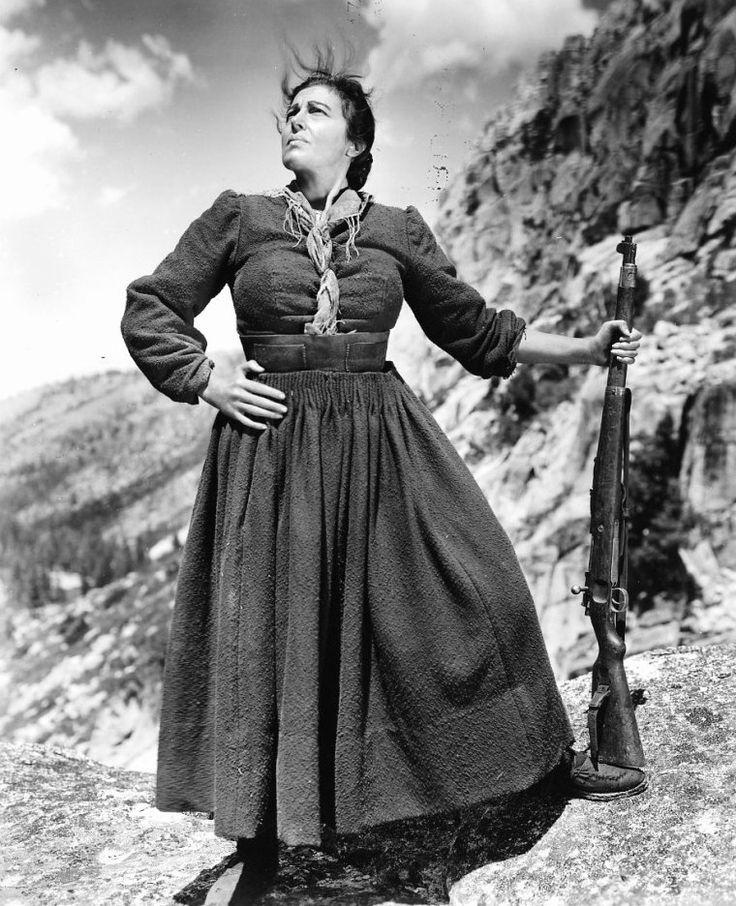 """On trouve également dans le film """"Pour qui sonne le glas"""", une autre actrice, Katina PAXINOU qui d'ailleurs remporta l'Oscar de la meilleure actrice dans un second rôle pour ce film : Katína PAXINOU (grec moderne : Κατίνα Παξινού), née Ekateríni Konstantopoúlou (Αικατερίνη Κωνσταντοπούλου) le 17 décembre 1900 au Pirée et morte le 22 février 1973 à Athènes, est une actrice grecque. (photos de l'actrice en compagnie d'Ingrid BERGMAN ou Gary COOPER dans le film """"Pour qui sonne le glas"""", et…"""