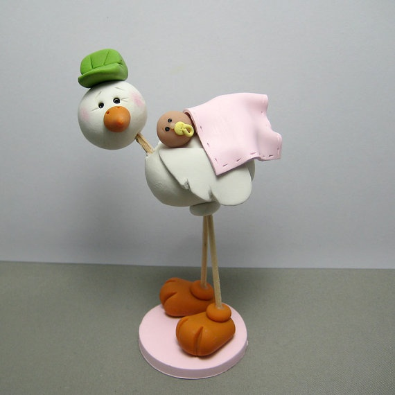Adorable stork cake topper