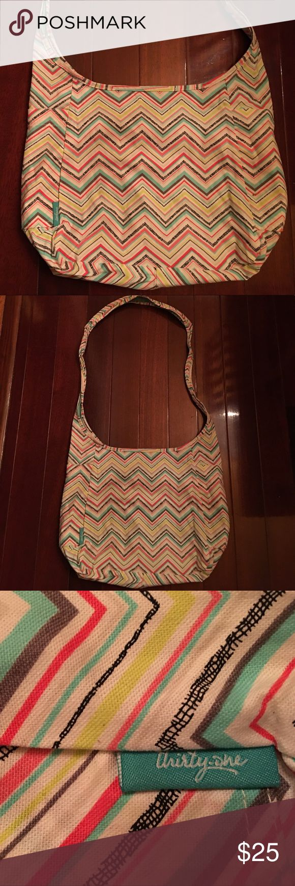 Thirty one Shoulder/crossbody Bag Thirty One shoulder/crossbody bag in excellent condition, gently used a few times. Very clean and fun design. Offers welcome and all purchases receive free gift 🎁! Thirty-One Bags Crossbody Bags
