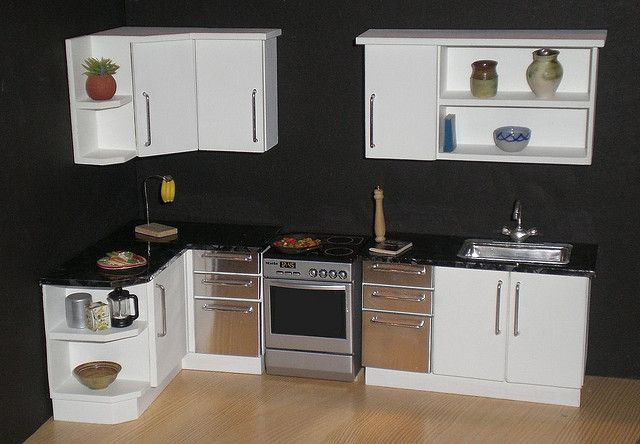 White modern 1/12th scale dollhouse kitchen    From my Mornington range of kitchens, this one is painted white, with steel drawer fronts either side of the stove. Open shelving gives plenty of space for displaying miniatures.