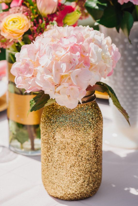 Mason jar floral centerpiece all glittered up with pale pink flowers.  So pretty