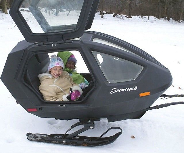 With the snowmobile carriage trailer you'll safely be able to bring the kiddies along for the trek through the winter wonderland. While you expertly navigate through the wilderness, the kids ride comfortably behind you in a sturdy and compact pod with one hell of a view.