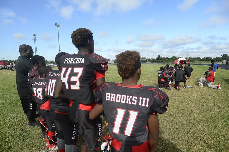 A divided crowd watched from the Ozen High School stands on Saturday morning as 14 of the 19 players on the Beaumont Bulls youth football team took a knee during the national anthem.  The silent protest, which began last week before a game against Pasadena, has put the local 11- and 12-year-olds in the middle of a national debate on race and has subjected them to online criticism, some of which has been threatening.  The team, which plays in the senior division of the Bay Area Football…
