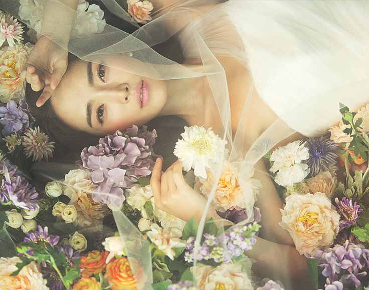 Romantic wedding photoshoot with a bed of florals // A Korean Concept Photoshoot Promotion for IDOWEDDING's 5th Anniversary