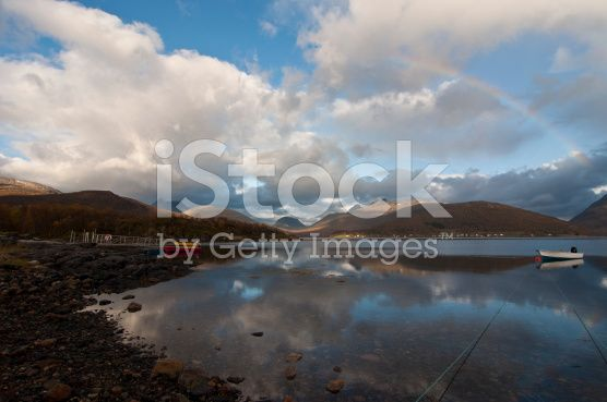 Norway, Norwegian fjord, boat and rainbow royalty-free stock photo