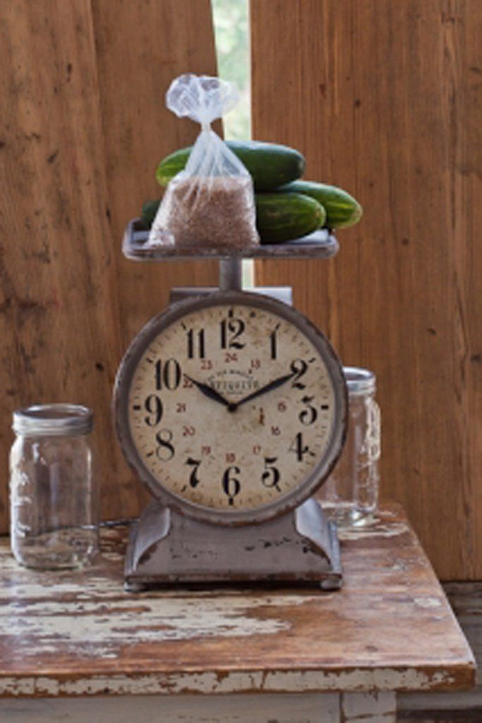 "This beautiful rustic, metal clock has bold vintage style numbers. Add a pop of vintage charm with present day to day function with this clock! - 9""x 9.5""x 14.5"" - Made of metal and glass. - Requires"