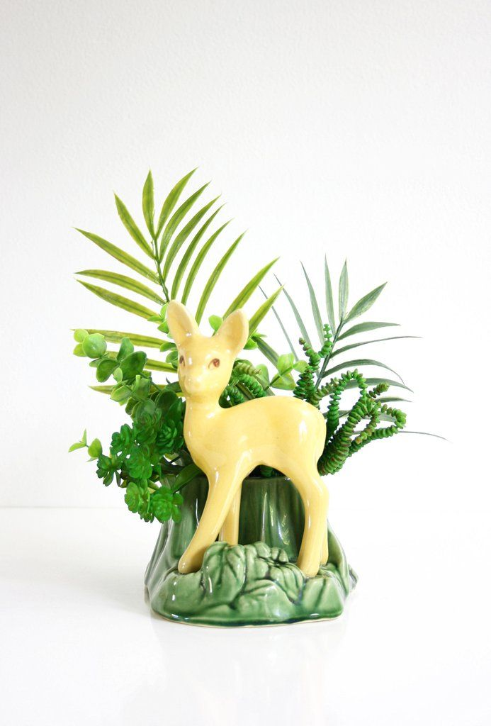 This absolutely adorable mid century deer planter by Shawnee is just so sweet! Made in the 1950s, this planter features great details and a bright yellow and green glaze. Perfect for making your favor