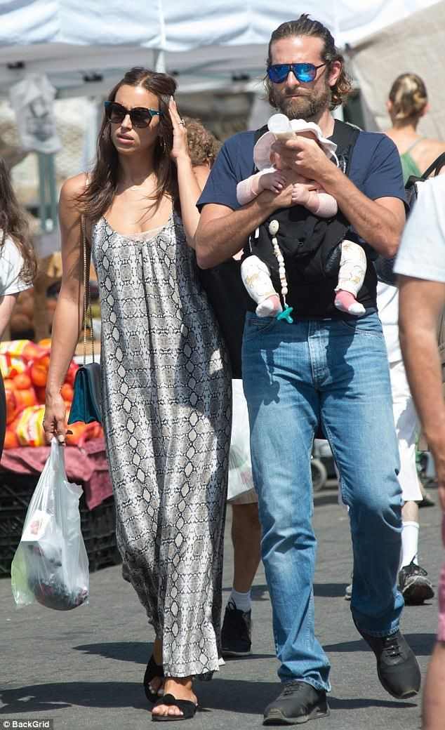 Family affair: Bradley Cooper and girlfriend Irina Shayk enjoyed a day at a Los Angeles-area farmers market with daughter Lea on Sunday