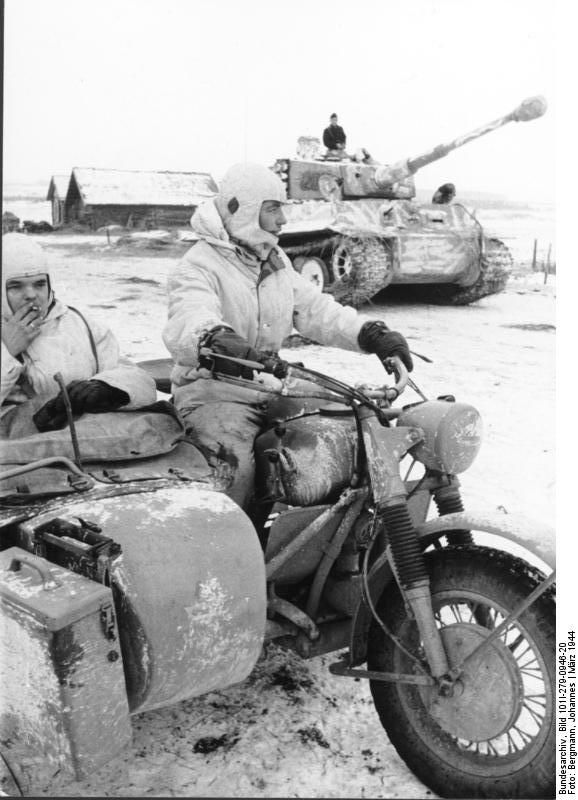 German Army PzKpfw VI Tiger I heavy tank and motorcycle, Russia, Mar 1944