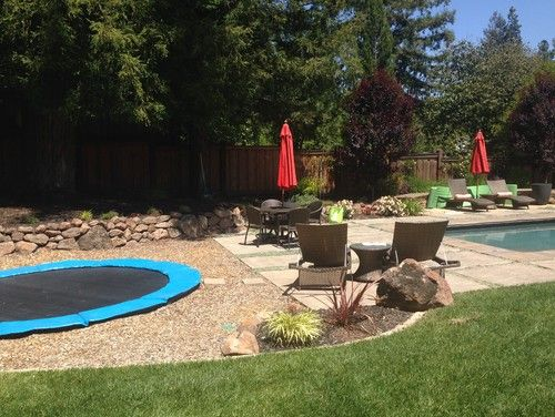 This is an example of a mid-sized eclectic full sun backyard xeriscape for spring. — Houzz trampoline by pool — mpedersen http://www.houzz.com/projects/281301/in-ground-trampolines