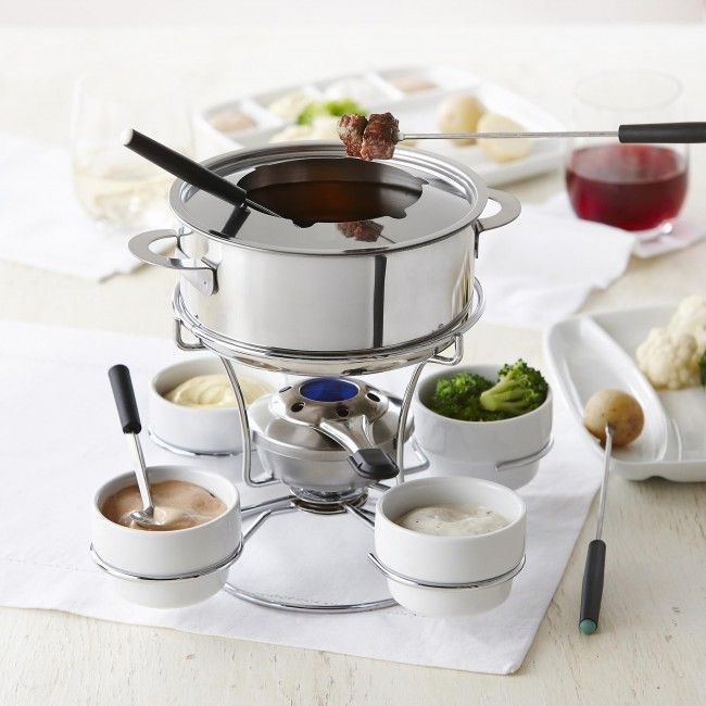 The Trudeau Maison Fenty 3 in 1 Fondue Set is ideal for chocolate, cheese and meat. The serving bowls rotate around the fondue pot so serving at a table is easy and convenient. It's ceramic double boiler is perfect for melting cheese and chocolate fondue.