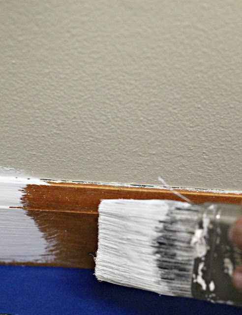 If your home is full of old brown trim, this post will tell you everything you need to know about how to paint your trim and doorways as painlessly and inexpensively as possible.