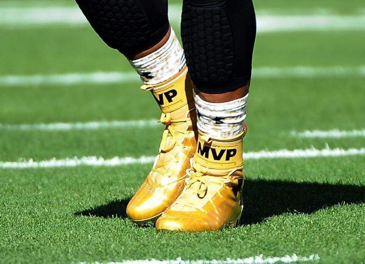 Cam Newton wears gold MVP shoes before Super Bowl 50 2/7/16.