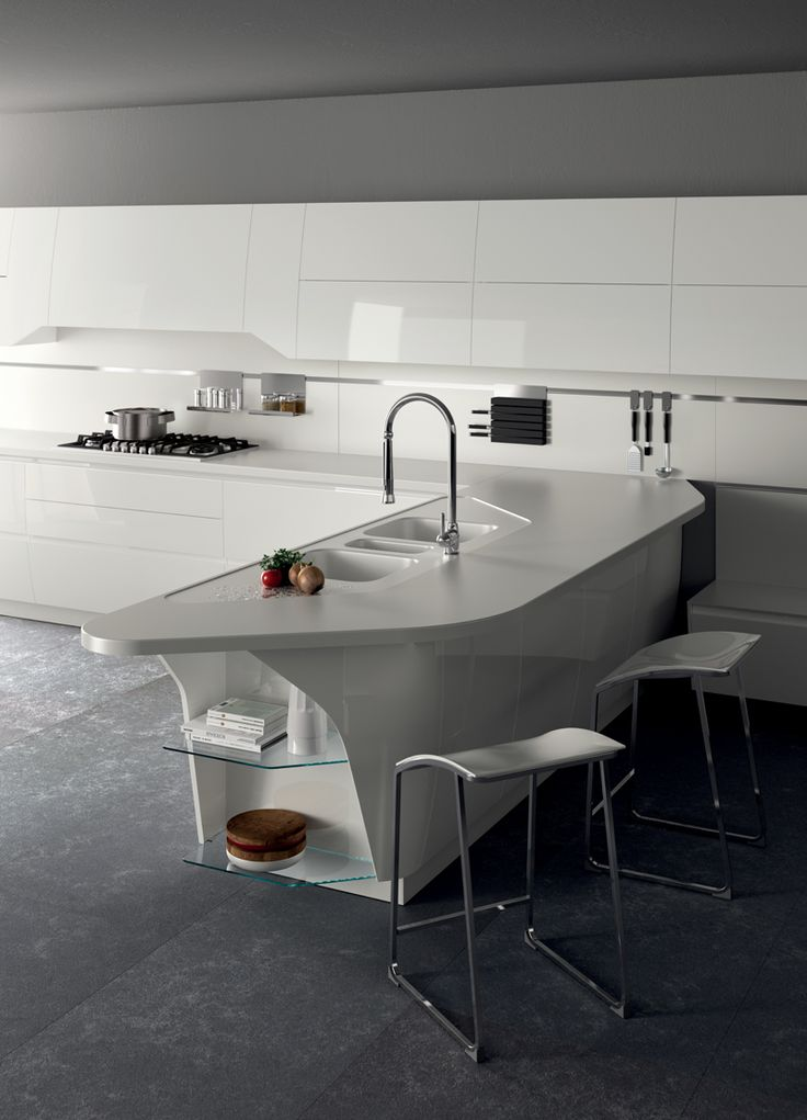 Interesting the silhouette of the breakfast counter with end base unit with a shaped door.
