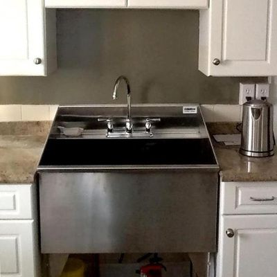 A heavy-duty, durable, and sanitary sink for your laundry room
