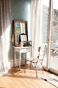 Warm light, a gorgeous clustering of treasured items...so lovely. bedroom table vanity