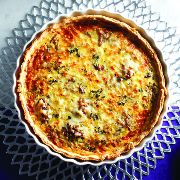 This French onion tart recipe is perfect for breakfast, brunch, lunch or dinner! It features a decadent blend of creamy gruyère, eggs and homemade dough.