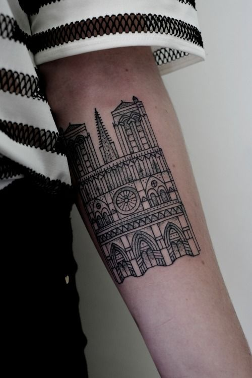 notre dame cathedral tattoo. unbelievably sharp linework. no shaky lines or anything. incredible.
