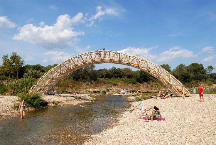 Proving cardboard can be a structurally sound building material, the Paper Bridge was constructed over the Gardon River in southern France in 2007. Erected for only six weeks, the bridge was made with cardboard tubes, recycled paper, and plastic steps, with a foundation of wood boxes filled with sand.