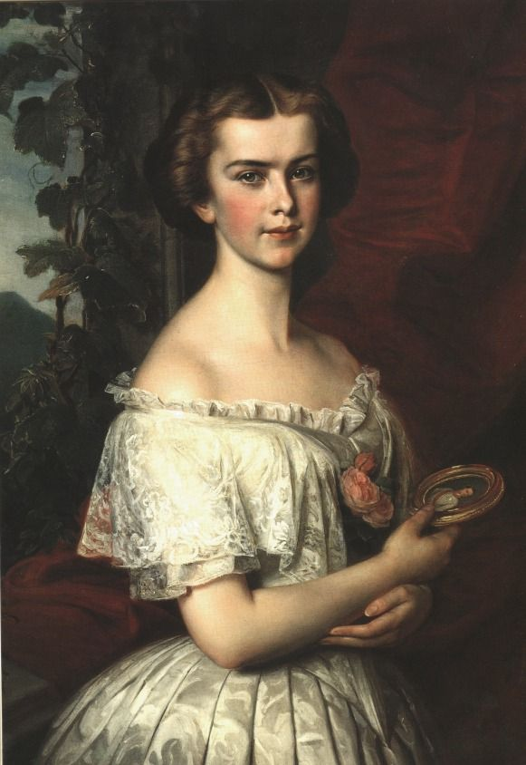 "Painting by unknown artist of Austrian Empress Elisabeth ""Sissi"" (Elisabeth Amalie Eugenie) (24 Dec 1837-10 Sep 1898) Bavaria as a young Lady. Sissi is wearing a brocade dress with a modesty piece on the top of the dress that is a small ruffle of the same material. Sissi is holding a small portrait of her future husband the Emperor Franz Joseph I (1830-1916) Austria."