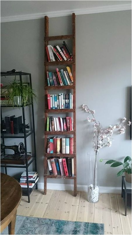 Place an old ladder close to the wall and secure it with screws to make the perfect bookshelf
