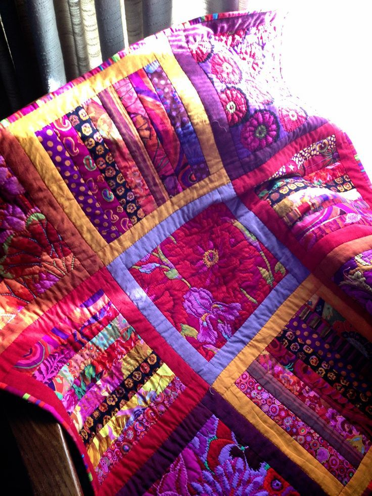 Kaffe Fassett inspired quilt | I like the alternation of strippy squares and big squares of a single fabric