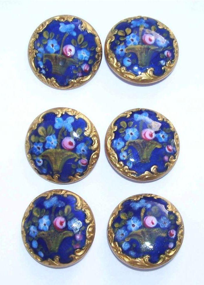 Antiguos botones en esmalte con motivos florales
