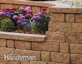 How to Choose the Right Retaining Wall Material - Step by Step | The Family Handyman.  Would be helpful for replacing the rotting railroad ties.