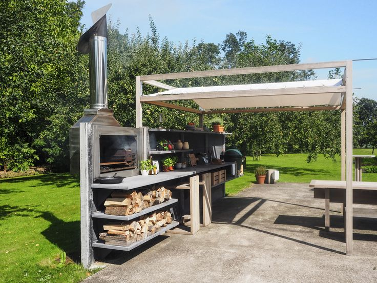 WWOO outdoor kitchen in anthracite with the integrated braai and the WWOO canopy | www.wwoo.nl