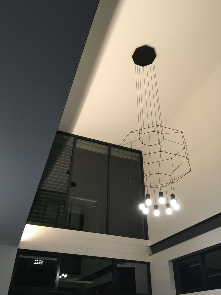 Vibia Wireflow in double height void by POC+P architects