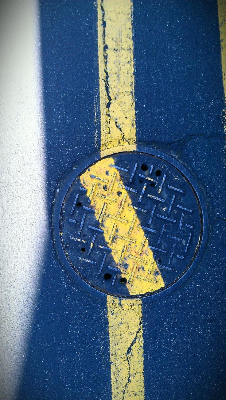 crooked manhole