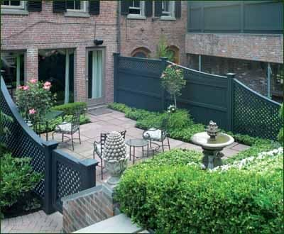 Urban Privacy Fence - Where city neighbors share an outdoor area, imagination and a smart use of space are required. Privacy with charm is exhibited in this verde green curved board fence with diagonal lattice topper. Stepped heights accommodate the transition from the private to the more open space.