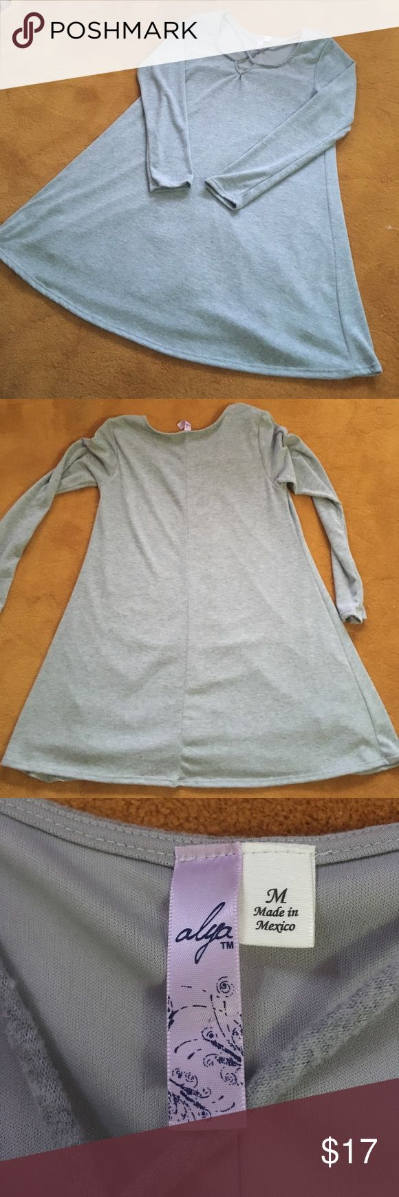 Long sleeved/ criss cross grey dress! Super cute, recently bought and never worn Francesca's grey long sleeved dress! Had a nice slip inside too. Perfect for fall or a cold summer day.  Has a cute criss cross design in front! Size medium! And it's stretchy! Francesca's Collections Dresses Long Sleeve