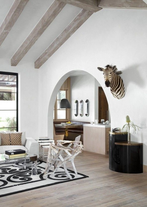 Neutral living room with faux zebra head art