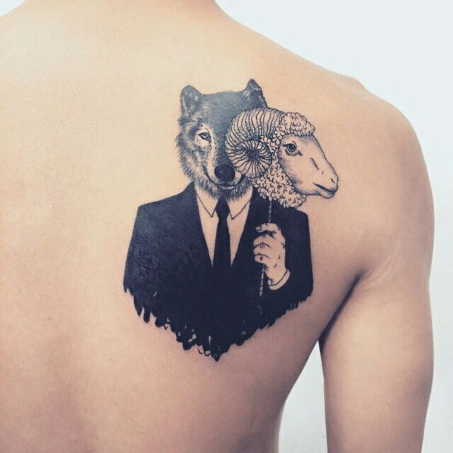 Wolf in sheep's clothing tattoo.