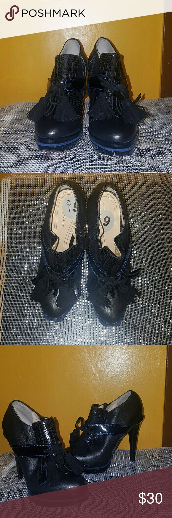 Black Cole Hann Shoes Black with Royal Blue stitching Cole Hann Shoes. Has tassels in the front and zips on the side.  Love these shoes but they're a little snug. Only tired on, never worn. Cole Haan Shoes Heels