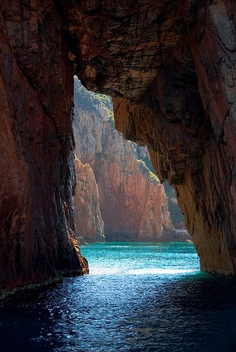 Island of Corsica - a French island in the Mediterranean Sea. It is located west of Italy.