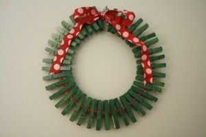 How cute would this be to do at a school Christmas party-- have each child write his or her name on the clothespin (could already be painted green and then have each make a card at one of your party stations. Then at the end of the party, the teacher gets a wreath of student made cards!