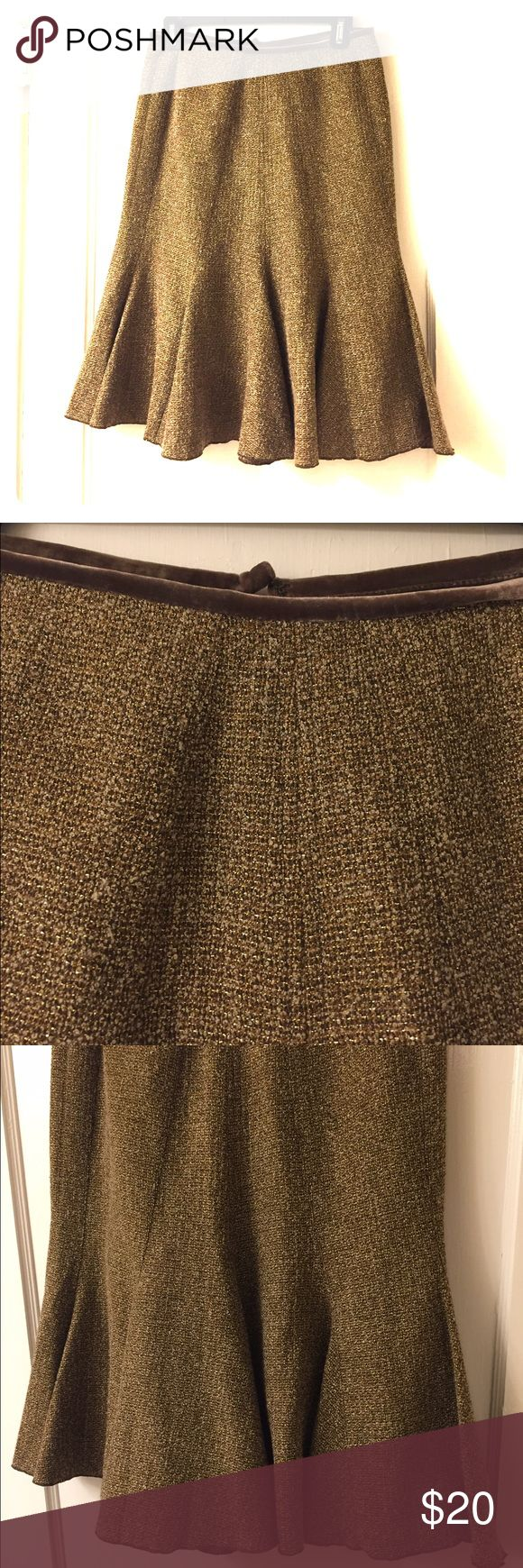 Nine West wool mix pleated skirt ~ Size 2 Nine West wool mix pleated skirt with slight tulip flair. Tan/brown mix with gold thread mixed in. Velvet detail at waist. Pretty and warm for fall/winter. Falls slightly below knee. Excellent condition. Size 2z Nine West Skirts Midi