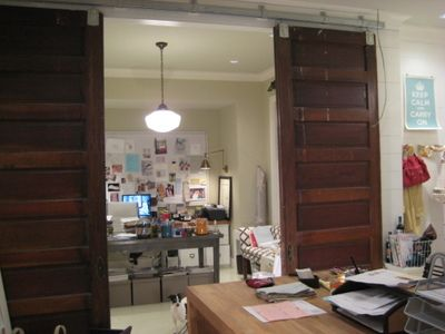 Double barn doors. A great way to add doors to an open space - no header?....