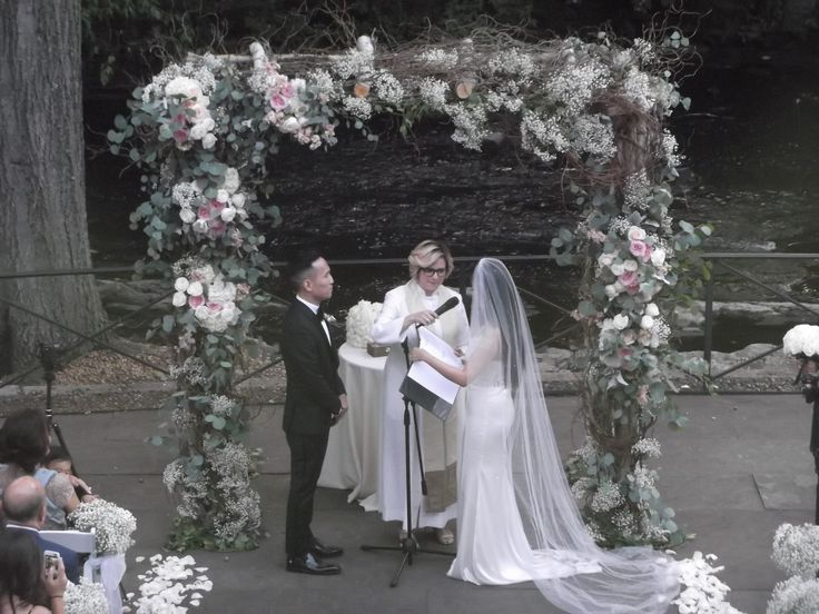 """This rustic birch chuppah from a recent event at the New York Botanical Gardens is decorated with """"Baby's Breath"""" natural flowers , """"David Austin"""" garden roses, and locally sourced eucalyptus foliage."""