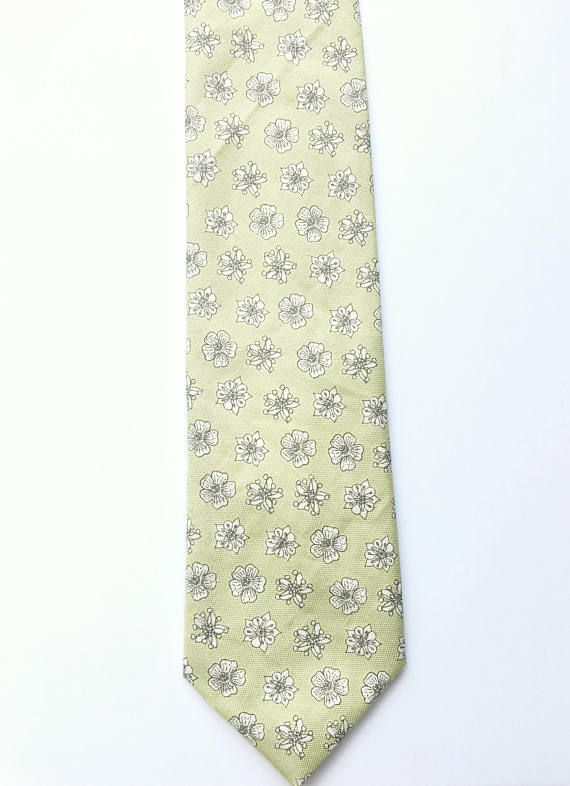 This lovely mens skinny tie has been handmade using a soft green floral cotton. FABRIC: Cotton. (Affiliate) Groom | Grooms Outfits | Advice for Grooms | Grooms Accessories | Wedding Suit | Groom Attire | Wedding Tie | Cravats | Buttonholes | Groomsmen | Groomsmen Outfits | Advice for Groomsmen | Groomsmen Accessories | Wedding Suits | Groomsmens Attire | Grooms Tie | Groomsmens Cravats | Groomsmens Buttonholes | Wedding Party