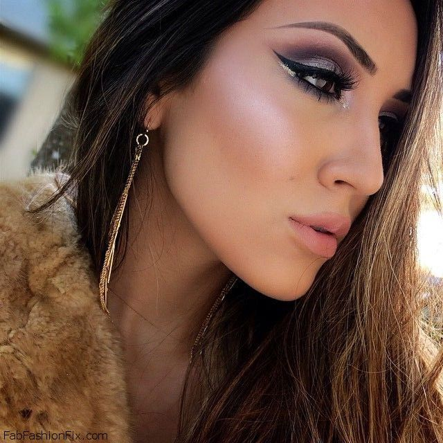 Perfectly contoured and highlighted face with purple smokey eyes and black winged eyeliner. #eyeliner #contour #makeup #highlight