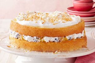 Layered Coconut Tres Leches Cake recipe - This impressive dessert is as moist as you'd expect a tres leches cake to be, plus it's layered with coconut, fresh pineapple and ripe blueberries.
