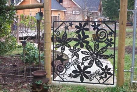 "whimsical yard art ideas | Metal Art Garden Gate Features ""Steel Flowers"" « Luxury Housing ..."