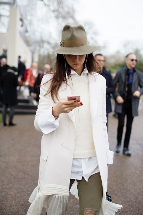 Great khaki hat with a white/cream outfit...